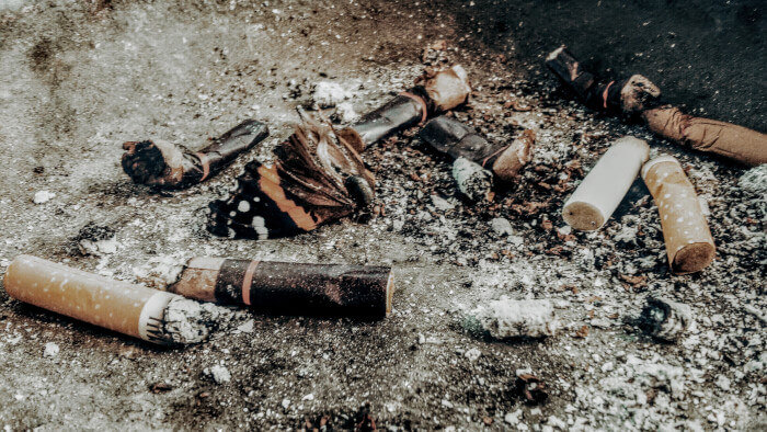 Cigarette butts on ground, use hypnotherapy to stop smoking